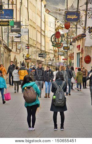 Salzburg Austria - March 23, 2016: Tourists walking and shopping in historic Getreidegasse Salzburg