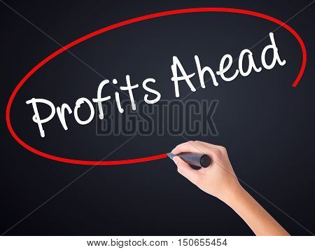 Woman Hand Writing Profits Ahead   With A Marker Over Transparent Board