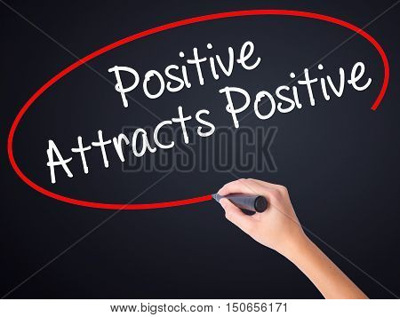 Woman Hand Writing Positive Attracts Positive With A Marker Over Transparent Board