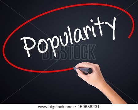 Woman Hand Writing Popularity With A Marker Over Transparent Board .
