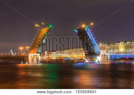 Night view of illuminated Neva River open Palace Bridge and Palace Embankment Saint Petersburg Russia