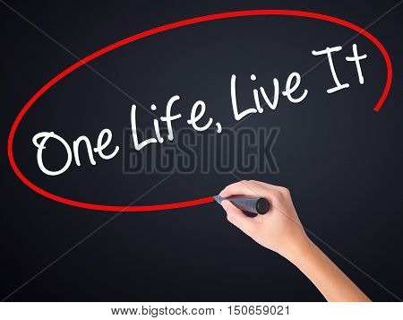 Woman Hand Writing One Life Live It With A Marker Over Transparent Board .