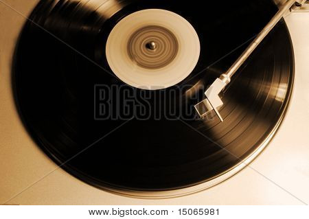 old vinyl player in sepia