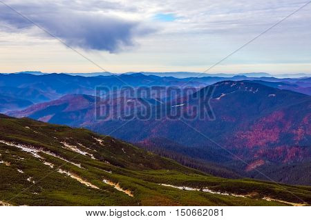 Autumnal Mountain View with many layers prospective and foggy remote ridges