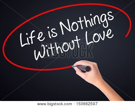 Woman Hand Writing Life Is Nothings Without Love With A Marker Over Transparent Board