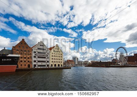 Gdansk Poland - October 04 2016: Old historic buildings of the old city on the Motlawa River waterfront in Gdansk