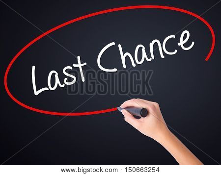 Woman Hand Writing Last Chance With A Marker Over Transparent Board