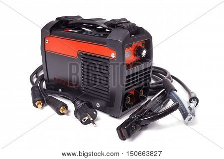 Inverter welding machine, welding equipment isolated on white background, high-voltage wires with clips, set of accessories for arc welding