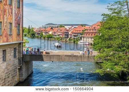 Bamberg Germany - May 22 2016: View to Lower Bridge over Regnitz River and the historic town hall in Bamberg Upper Franconia Bavaria Germany.