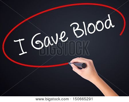 Woman Hand Writing I Gave Blood With A Marker Over Transparent Board