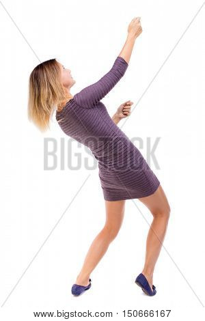 back view of standing girl pulling a rope from the top or cling to something. girl  watching. Rear view people collection.  backside view of person.  Isolated over white background. The girl in a