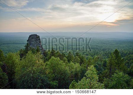 Amazing landscape with mountain range and beautiful blue sky at sunset, Russia, Ural, Europe - Asia boundary.