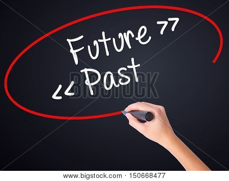 Woman Hand Writing Future - Past With A Marker Over Transparent Board .