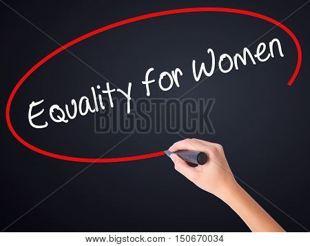 Woman Hand Writing Equality For Women With A Marker Over Transparent Board .