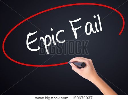 Woman Hand Writing Epic Fail With A Marker Over Transparent Board