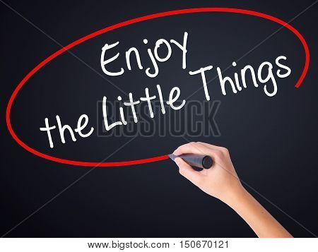 Woman Hand Writing  Enjoy The Little Things With A Marker Over Transparent Board