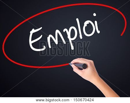 Woman Hand Writing Emploi (employment In French) With A Marker Over Transparent Board