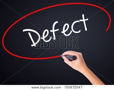 Woman Hand Writing Defect With A Marker Over Transparent Board