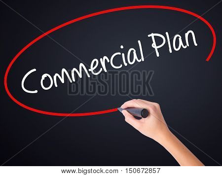 Woman Hand Writing Commercial Plan With A Marker Over Transparent Board .
