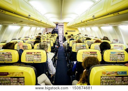 Trieste Italy - May 23 2016: People are sitting on Ryanair flight from Trieste - Italy to Valencia - Spain. The inside of low-cost budget airline commercial plane Boeing 737-800.