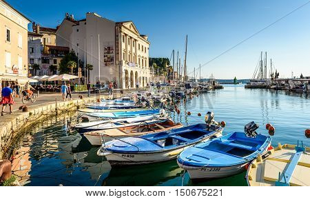 Piran Slovenia - September 24 2016: People are walking in the city of Piran late in the evening.