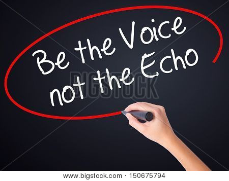Woman Hand Writing Be The Voice Not The Echo With A Marker Over Transparent Board .