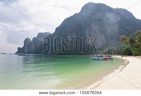 A beach on Phiphi Don island in the Andaman Sea in Thailand on a blue sky summer day.