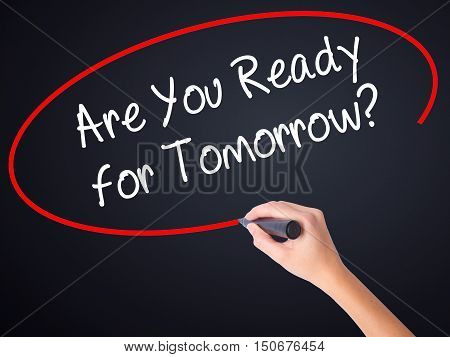 Woman Hand Writing Are You Ready For Tomorrow? With A Marker Over Transparent Board .