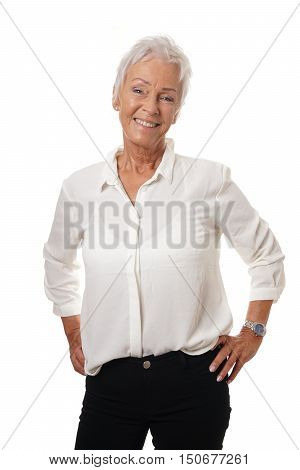 stylish and trendy mature woman in her sixties smiling