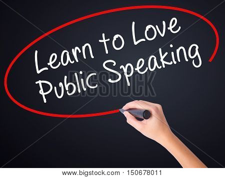 Woman Hand Writing Learn To Love Public Speaking With A Marker Over Transparent Board