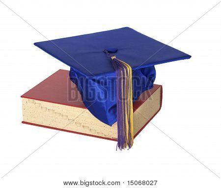 Graduate Hat On Book