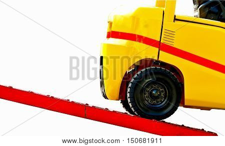Forklift on loading dock close up isolated on white background