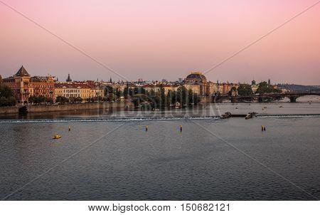 scenery of prague skyline and Vltava river in the purple sunset light