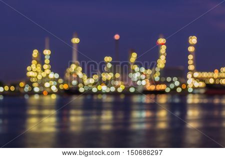 Blurred light oil refinery river front night view, abstract background