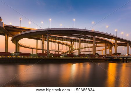 Highway interchanged riverfront with clear sunset sky background