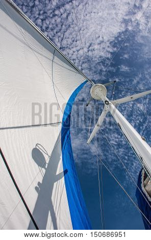 Looking up to Mast and sail against with beautiful blue sky cloud background at luxury sailing yacht in sunny dayPhuketThailand