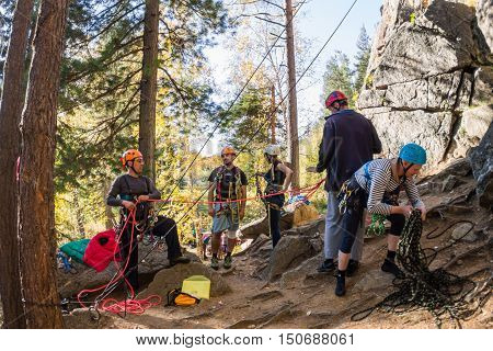 Rocks Vityaz, Irkutsk - Russia In September 2016. The Team Of Climbers Start Climbing The Rock. Duri