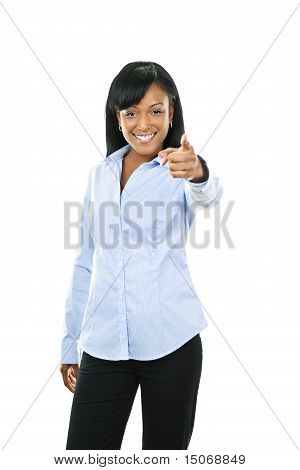 Smiling Young Woman Pointing Finger