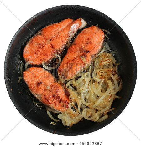 Salmon steak and onion at the pan