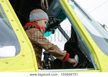 Tyumen, Russia - August 23, 2008: Air show On a visit at UTair in heliport Plehanovo. Girl sitting in cabin of MI-8 helicopter