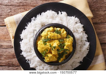 Indian Cuisine: Korma Chicken In Coconut Sauce And Basmati Rice. Horizontal Top View