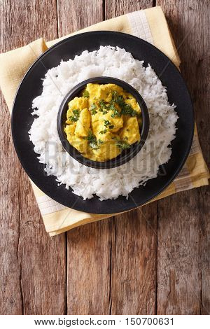 Chicken Korma Of Coconut And Cream Sauce Served In A Rice. Vertical Top View