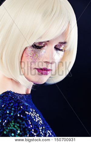 Perfect Lady Fashion Model with Artistic Glitters Makeup and Blonde Hair. Beauty Portrait of Beautiful Woman. Face closeup