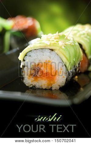 Fresh And Delicious Maki And Nigiri Sushi And Sake On The Black Glass.