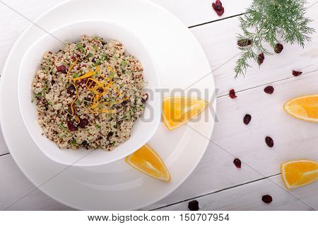 Quinoa salad with cranberries and orange. Superfoods concept. View from above