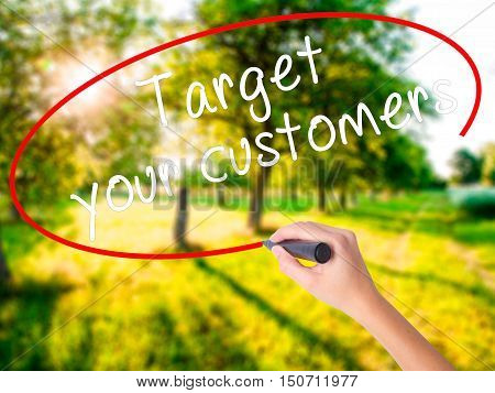 Woman Hand Writing Target Your Customers With A Marker Over Transparent Board