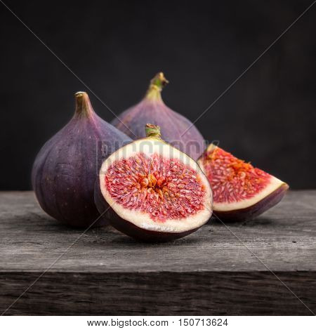 Sliced ripe figs on a wooden table