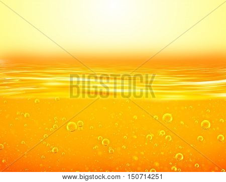 Orange yellow Liquid with oxygen bubbles. Oil. Honey. Beer. Juice. Closeup. Orange yellow waves and sky.