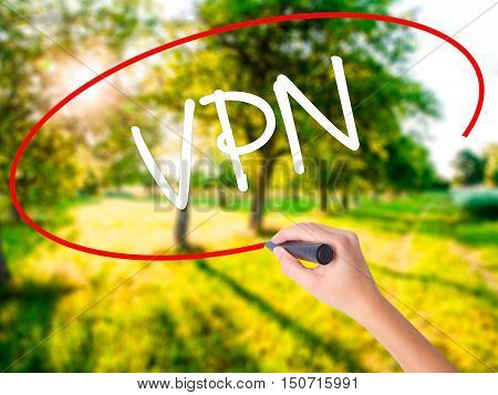 Woman Hand Writing Vpn (virtual Private Network) With A Marker Over Transparent Board