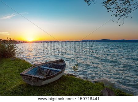 Beautiful sunset over Lake Balaton with a boat in the front